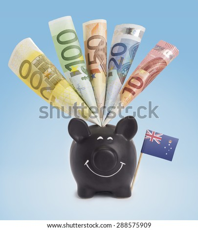 Ten,twenty,fifty,one hundred and a 200 Euro banknote in a smiling piggybank of Victoria.(series) - stock photo