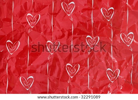 Ten white hearts and arrows on creased red paper - stock photo