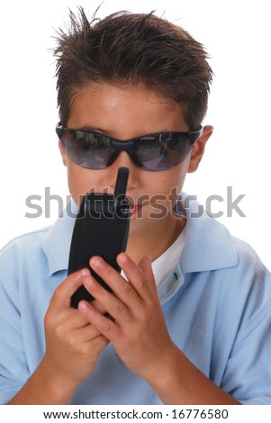 Ten year old boy wearing sunglasses and holding a cellphone
