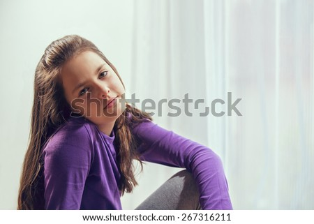Ten year old caucasian girl with long hair posing - stock photo