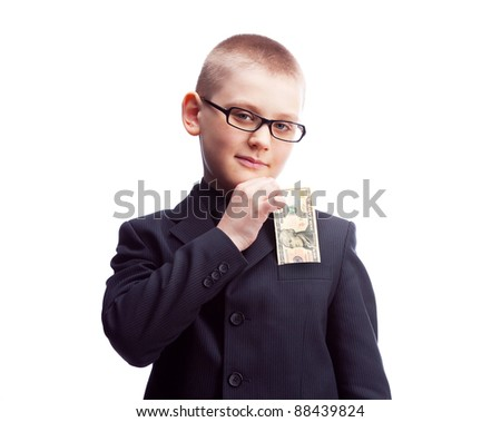 ten year old  confident boy wearing a costume putting ten dollars into his pocket - stock photo