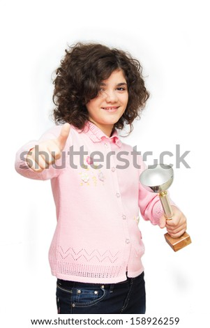 Ten year old girl holding winner cup . Isolated on white. - stock photo
