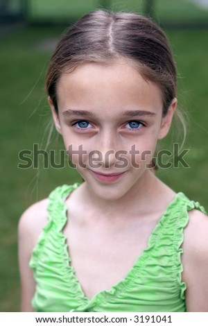 Ten year old girl in the park - stock photo