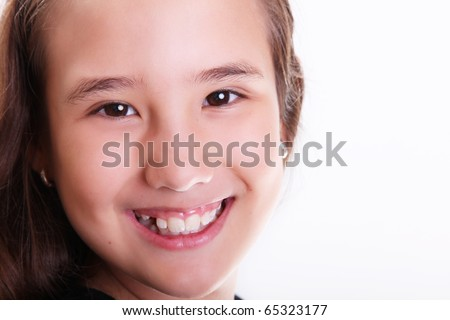 Ten years old girl smiling and looking at the camera, Close up, white background - stock photo