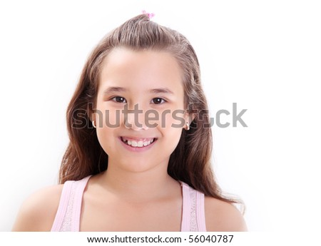 Ten years old girl smiling and looking the camera. Only face