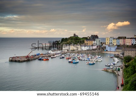 Tenby Harbour in Wales at sunset - stock photo