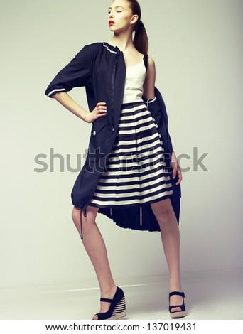 Tendency. Beautiful Fashion Model in Outwear. Elegance - stock photo