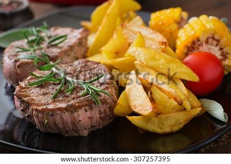Tender and juicy veal steak medium rare with French fries - stock photo