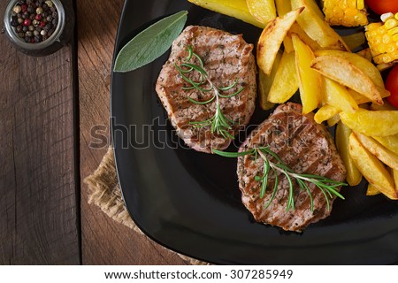 Tender and juicy veal steak medium rare with French fries. Top view - stock photo