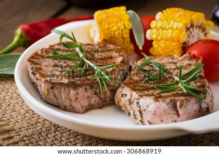 Tender and juicy veal steak medium rare with vegetables - stock photo