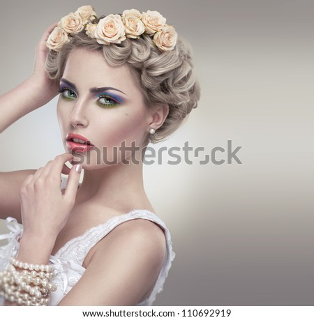 Tender beauty portrait of bride with roses wreath in hair - stock photo