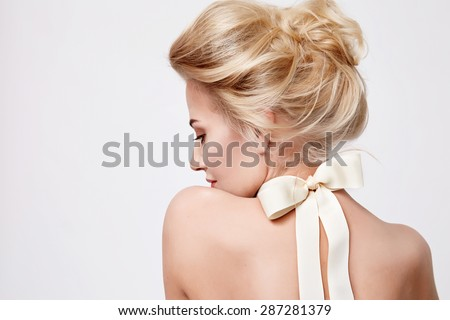 Tender fashion portrait of beautiful gentle young blond woman with silk bow on the neck cosmetics for body face hair pure natural beauty, organic and diet harmony, makeup - stock photo