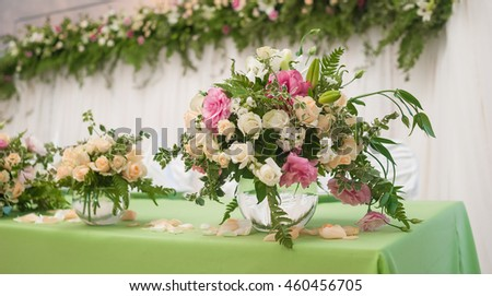 Tender flower composition in a glass vase in the form of a sphere. Decoration of a wedding