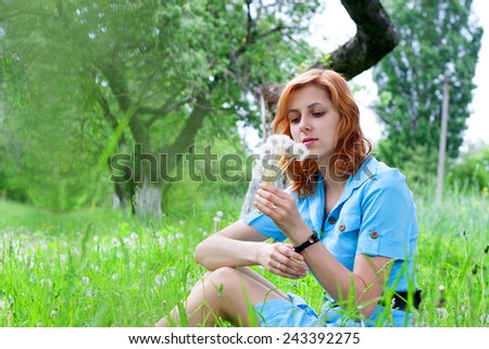 tender girl in nature in the grass