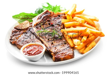 Tender grilled porterhouse or t-bone steak served with crisp golden French fries and fresh green herb salad accompanied by a BBQ or tomato ketchup sauce - stock photo