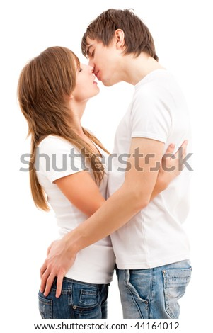 Tender kissing of a young happy couple. Isolated over white - stock photo