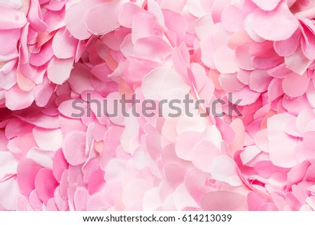 Tender pink textile petals wave. Flower blossom wallpaper, top view
