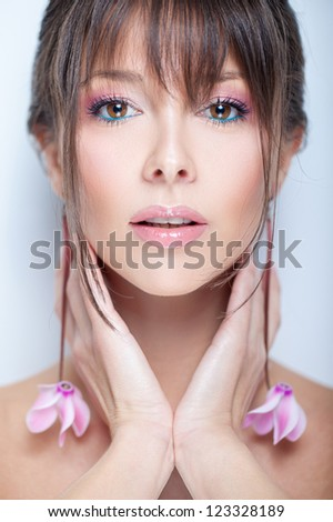 Tender portrait of a pretty girl with organic flower accessories