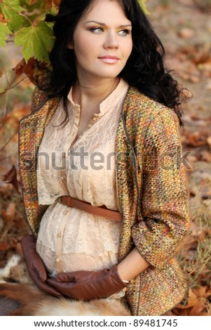 Tender pregnant woman outdoors - stock photo