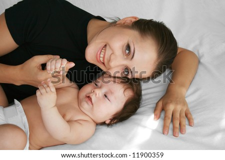 Tender young mother and happy child together