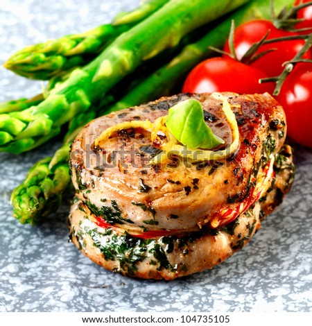 Tenderloin steak and asparagus and some tomatoes. Fresh red meat meal menu - stock photo
