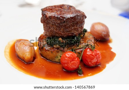 Tenderloin steak with potato puree, spinach and vegetables, close-up - stock photo