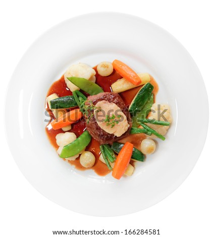 Tenderloin steak with vegetables and bone marrow isolated on white background - stock photo