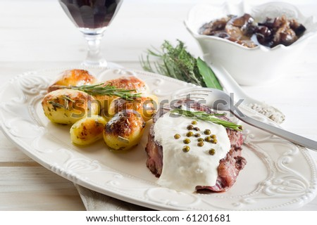 tenderloin with cream sauce and green pepper - stock photo