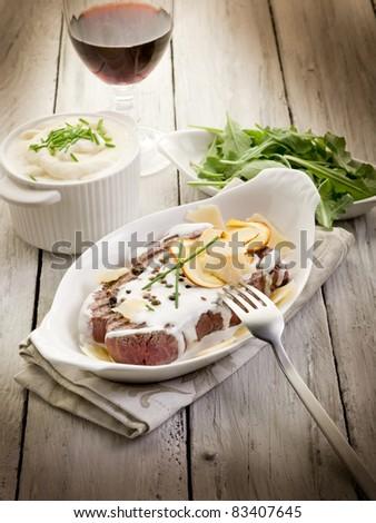 tenderloin with cream sauce ovum mushroom and arugula salad - stock photo