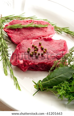 tenderloin with herbs - stock photo