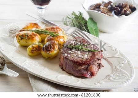 tenderloin with potatoes - stock photo