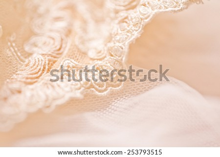 Tenderness peachys lingerie with candle and motif. Love mood. - stock photo