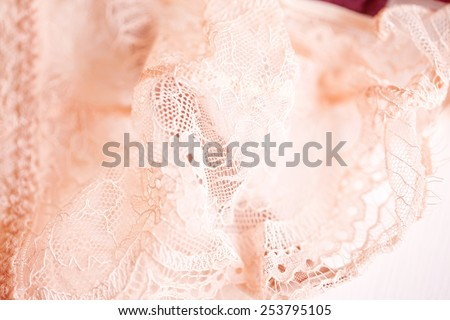 Tenderness peachys lingerie with roses petails, candle and accessories. Love mood. - stock photo