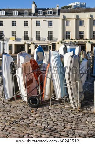Tenders on Torquay Harbour quayside, Devon, England - stock photo