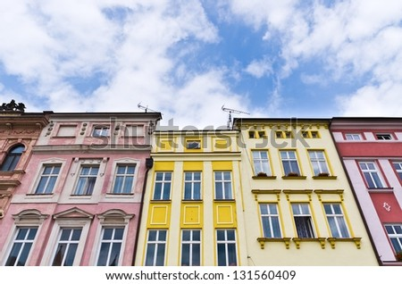 Tenement houses and blue sky - stock photo