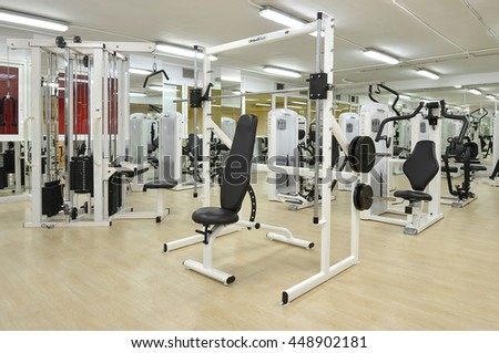 TENERIFE, CANARY ISLANDS - MARCH 27, 2012: Machines lifting weights in a gym
