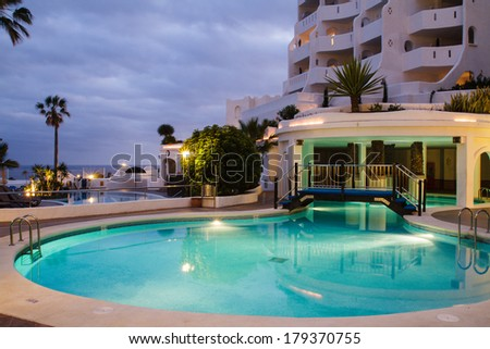TENERIFE ISLAND, SPAIN - MARCH 25: Swimming pools of a luxury hotel in town Golf del Sur on March 25, 2011. This is a popular place for tourists on Tenerife island.