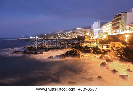 Tenerife - Puerto de la Cruz. Long exposure night scene showing the waterfront.