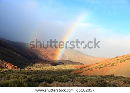 Tenerife. Scene from Teide National Park, Teide, the volcano on tenerife, the Canary Islands. Double rainbow all the way... - stock photo