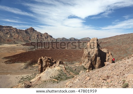 Tenerife. The famous tourist attraction on Teide, Tenerife: Los Roques de Garcia. Here with model released hiker in the scenic landscape. - stock photo