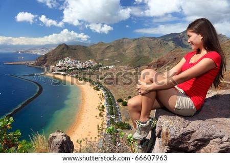 Tenerife. Woman traveler tourist looking at beach view. Playa de las Teresitas, Tenerife, Canary Islands, Spain. - stock photo
