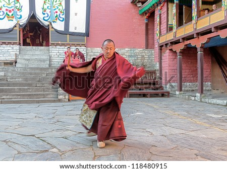 TENGBOCHE, NEPAL - OCTOBER 29: The monk performs dance of his own monastery. Festival of Tengboche Monastery Practice and Masked Mani Rimdu Dances to the Khumbu region on October 29, 2012 in Tengboche - stock photo