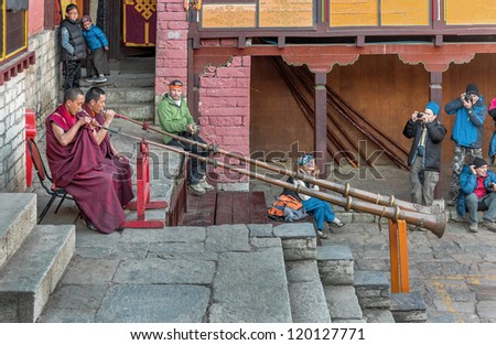 TENGBOCHE, NEPAL - OCTOBER 29: The monks accompany dances of trumpets. Festival of Tengboche Monastery Practice and Masked Mani Rimdu Dances to the Khumbu region on October 29, 2012 in Tengboche, Nepal - stock photo