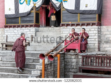 TENGBOCHE, NEPAL - OCTOBER 29: The monks accompany dances of trumpets. Festival of Tengboche Monastery Practice and Masked Mani Rimdu Dances to the Khumbu region on October 29, 2012. Tengboche, Nepal - stock photo