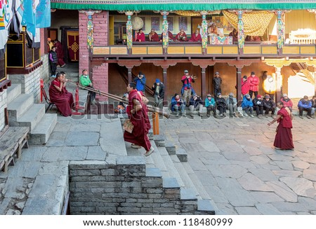 TENGBOCHE, NEPAL - OCTOBER 29: The monks perform group ritual dance. Festival of Tengboche Monastery Practice and Masked Mani Rimdu Dances to the Khumbu region on October 29, 2012 in Tengboche - stock photo