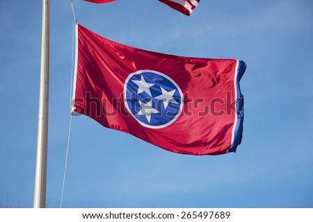 Tennessee State Flag in blue sky, Nashville, Tennessee  - stock photo