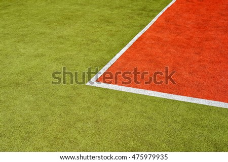 tennis artificial green and red grass court