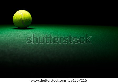 Tennis background - low key ball in corner with green surface - stock photo