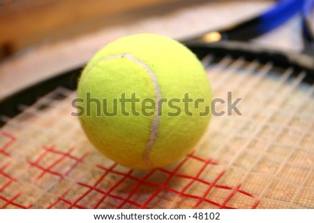 Tennis ball and racket.
