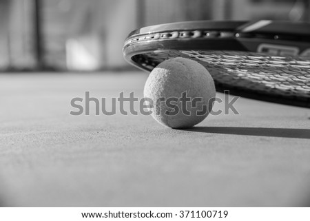 Tennis Ball and Racket , black and white - stock photo